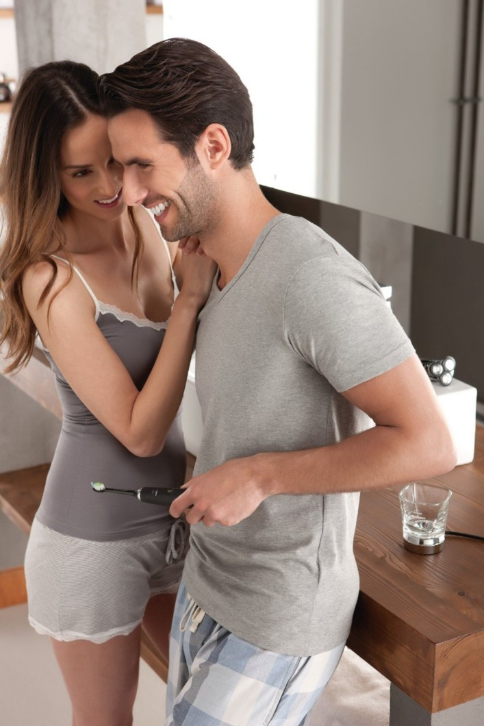 Man and Woman laughing over Philips Sonicare DiamondClean